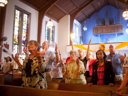 Congregants pray during Catholic mass at St. Therese Little Flower parish in Kansas City, Mo. on Sunday, May 20, 2012.