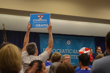 A man holds up a signs that reads 'Stonewall Democrats for Obama' during the LGBT caucus of the 2012 Democratic National Convention in Charlotte, N.C. on Tuesday Sept. 4, 2012.