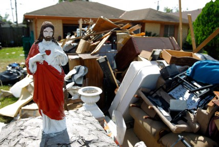 With their life contents on the curb, a statue of Jesus at the LeBlanc's residence - 709 St. Andrews Blvd. in LaPlace Saturday Sept. 15, 2012.