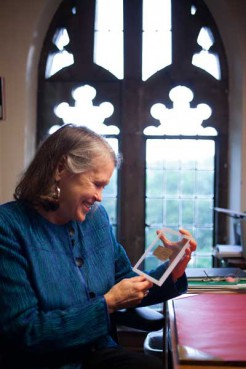 Karen L. King, the Hollis Professor of Divinity at Harvard University holds a previously unknown ancient papyrus fragment from Egypt that has four words written in Coptic that provide the first unequivocal evidence that within 150 years of his death, some followers of Jesus, believed him to have been married.