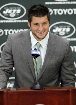 Quarterback Tim Tebow addresses the media during his debut with the New Jersey Jets in Florham Park, N.J., on March 26, 2012.