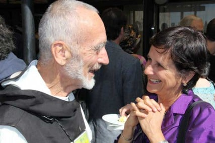 Brother David Steindl-Rast, author and Benedictine monk, talks with Thais Corral, a Brazilian social entrepreneur, at the Fetzer Institute Global Gathering in Assisi, Italy.