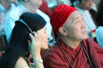 Hsin Tao, founder of the Museum of World Religions in Taiwan, listens to the proceedings with an assistant.