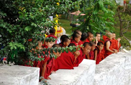 "Student lamas await the arrival of the royal bride in Bhutan on Oct. 13, 2011. Political leaders in the tiny Buddhist nation of Bhutan have announced a nearly six-month ban on all public religious activities ahead of the upcoming elections, citing the Himalayan nation's constitution that says ""religion shall remain above politics."""