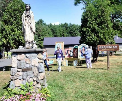 Hundreds of people visit the National Kateri Shrine and Indian Museum on Route 5 in Fonda, NY on Saturday July 21, 2012. Saint Kateri was baptized and lived there from 1666-1677. The main building houses St. Peterís Chapel, the Blessed Kateri Chapel and the Native American Exhibit. Visitors walk past a statue of her and a sign stating what was believed to be her last words. Saint Kateri, a Mohawk, will be one of seven Saints inducted during a Canonization ceremony at the Vatican on October 21, 2012.