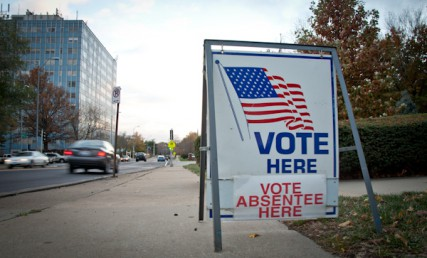 A 'Vote Here' sign sits on Wornall Rd. in front of a church in Kansas City, Mo. several days before the 2012 Presidential election.