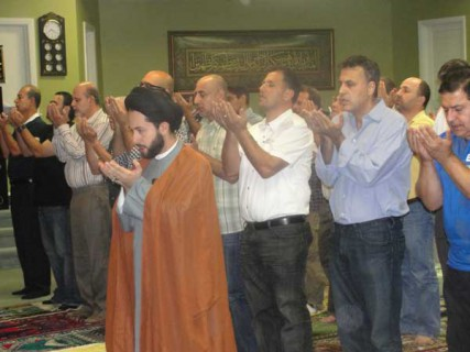 Sayed Mohammad Jawad Al-Qazwini leads prayers at the Iman Islamic Center in Quincy, Mass.