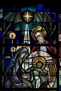 The stained-glass nativity scene at New York Avenue Presbyterian Church in Washington shows the infant Jesus in a manger. Scholars point to Jesus' birth in such humble surroundings as evidence of divine humility. Religion News Service photo by David Jolkovski.