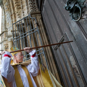 Bishop Justin Welby knocks at the doors of Durham Cathedral during his installation ceremony last year.