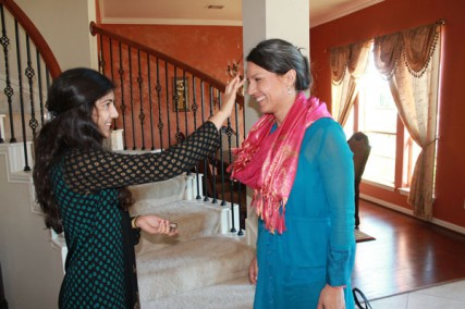 Namita Pallod welcomes Tulsi Gabbard to her father's Houston home for a fundraiser on October 28, 2012.