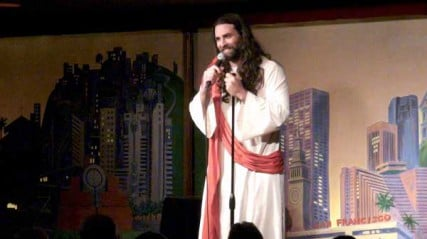 """Man, this is weird for me too,"" says comedian Matt Gubser, his long brown hair flowing freely over a white robe, scarlet sash and a pair of shower shoes. ""To be in a room where I don't recognize a single person. And you call yourself a Christian nation."""