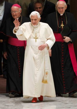Pope Benedict XVI waves as he arrives to lead his general audience in Paul VI hall at the Vatican Feb. 8.