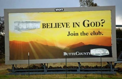 "A billboard posted in Chico, Calif., that originally read ""Don't believe in God? Join the club"" was defaced on Dec. 12, less than a week after it appeared, with vandals removing the word ""don't.""  RNS photo courtesy United Coalition of Reason"