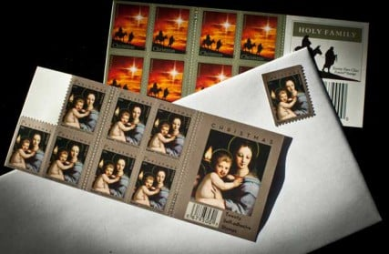 The 2011 (front) and 2012 Christmas stamps issued by the United States Post Office.