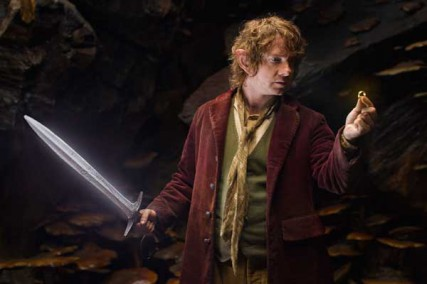 """Martin Freeman as the Hobbit Bilbo Baggins with his sword, Sting, finds a small ring in Gollum's cave in the fantasy adventure """"THE HOBBIT: AN UNEXPECTED JOURNEY,"""" a production of New Line Cinema and Metro-Goldwyn-Mayer Pictures (MGM), released by Warner Bros. Pictures and MGM."""
