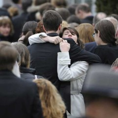 Mourners embrace outside Green Funeral Home in Fairfield, CT during the funeral for Noah Pozner, a victim of the Newtown shootings.