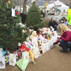 Memorial of candles, flowers, stuffed animals, and cards for the children and 6 adults who died at the Sandy Hook Elementary School