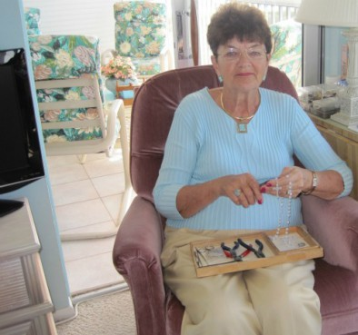 At age 75, Betty Holden is on a crusade to repair broken rosaries. She's been at it for almost 20 years, spending several hours a day behind a pair of needle-nose pliers.  Note: This image is not available to download.