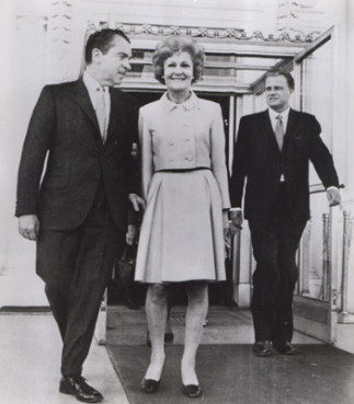 Washington, DC -- Sunday service at the White House.  President and Mrs. Nixon and Billy Graham walk outside following worship services, conducted by Graham, and held in the East Room. Religion New Service file photo (1969)