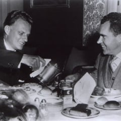 Billy Graham pours coffee for Vice-president Richard M. Nixon at a Washington luncheon.