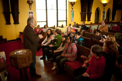 Pastor Rick Behrens speaks to the children during the bilingual Sunday morning service at Grandview Park Presbyterian Church in Kansas City, Kan. on Jan. 13, 2013. RNS photo by Sally Morrow.