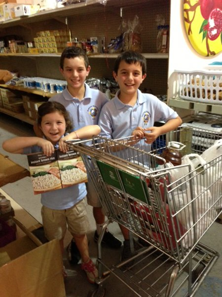 Students from area Jewish schools donate food and stock the shelves at the Jewish Community Services Kosher Food Bank in North Miami Beach as part of the