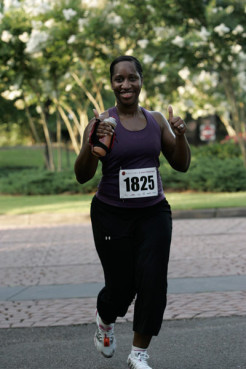 Marathon Makeover participant Shunika Stallworth gives a thumbs-up sign while running.  RNS photo by Sports In Motion.