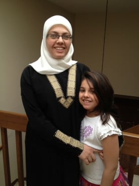 Jomana Al-Hinti of Toledo, Ohio, whose daughter Reema is a second grader in the Ohio Virtual Academy, gives her daughter daily Arabic lessons and twice-weekly Quran lessons that would be much harder to do if she attended a regular school.  RNS photo courtesy Jomana Al-Hinti.
