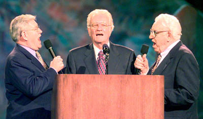 Evangelist Billy Graham is joined at a 2000 crusade in Jacksonville, Fla., by his longtime musical associates Cliff Barrows and George Beverly Shea