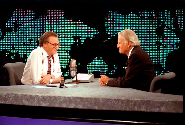 Billy Graham, right, during an interview on CNN's