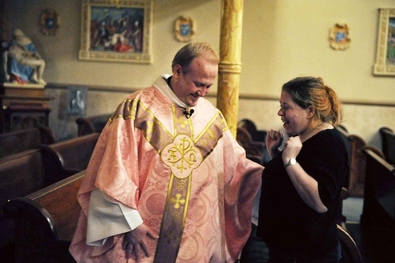 Patricia Darek lets out a small cheer as she talks with the Rev. Marek Bozek following a celebratory Mass at St. Stanislaus Kostka Church in St. Louis, after a judge ruled in the church's favor in a decade-long dispute between the historic Polish church and the Archdiocese of St. Louis. RNS photo by Erik M. Lunsford / The Post-Dispatch.