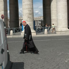 An unidentified Cardinal walking toward the Domus Santa Martha, the hotel where the Cardinals live during the Conclave. Many Cardinals cruise the streets of Rome by chauffered car; but some prefer the old fashioned method of transportation.  Photo by Rene Shaw.