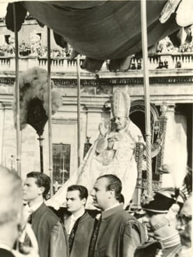Pope John XXIII is carried on a papal throne to the opening session of the Second Vatican Council in 1962. John called for the council on Jan. 25, 1959. Religion News Service file photo