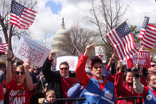 (RNS) Supports of gay marriage rally outside the U.S. Supreme Court as justices heard a challenge to the 1996 Defense of Marriage Act. RNS photo by Kevin Eckstrom.
