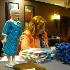A Madalyn Murray O'Hair doll up for auction greets attendees at American Atheists' 50th annual convention in Austin.  RNS photo by Kimberly Winston
