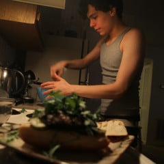 Vlad Chituc, 23, stirs Quinoa Tabbouleh near an already-made portobello burger at his apartment in Durham, N.C., Wednesday, March 13, 2013.  Chituc, an atheist, is participating in Lent by converting from vegetarian to vegan, something he hopes to continue indefinitely as an act of good morals and good health. RNS photo by Ted Richardson