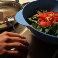 Vlad Chituc, 23, prepares Quinoa Tabbouleh and a portobello burger at his apartment in Durham, N.C., Wednesday, March 13, 2013.  Chituc, an atheist, is participating in Lent by converting from vegetarian to vegan, something he hopes to continue indefinitely as an act of good morals and good health.   RNS photo by Ted Richardson