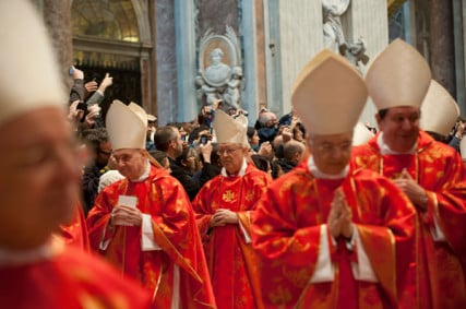 Cardinals enter Mass at St. Peter's Basilica on March 12, 2013 at the Vatican. RNS photo by Andrea Sabbadini