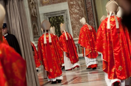 "Cardinals enter ""Pro Eligendo Pontifice"" Mass at St. Peter's Basilica on March 12, 2013 at the Vatican. RNS photo by Andrea Sabbadini"