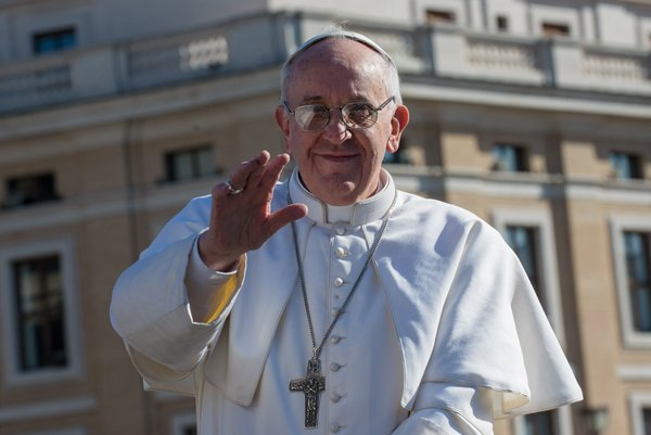Pope Francis waves from the pope-mobile during his inauguration Mass at St. Peter's Square on Tuesday (March 19) at the Vatican. World leaders flew in for Pope Francis' inauguration Mass in St. Peter's Square on Tuesday where Latin America's first pontiff will receive the formal symbols of papal power.  RNS photo by Andrea Sabbadini