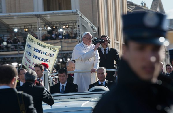 Pope Francis waves from the pope-mobile during his inauguration Mass at St. Peter's Square on Tuesday (March 19) at the Vatican. RNS photo by Andrea Sabbadini