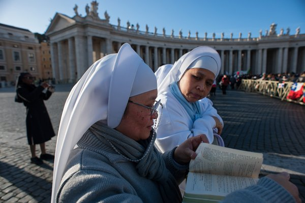 Nuns attend the inauguration Mass of Pope Francis at St. Peter's Square on Tuesday (March 19) at the Vatican. RNS photo by Andrea Sabbadini