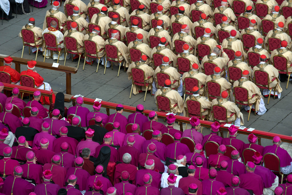 Cardinals listen during Pope Francis' grandiose inauguration Mass on Tuesday (March 19) at St. Peter's Square in the Vatican. RNS photo by Andrea Sabbadini