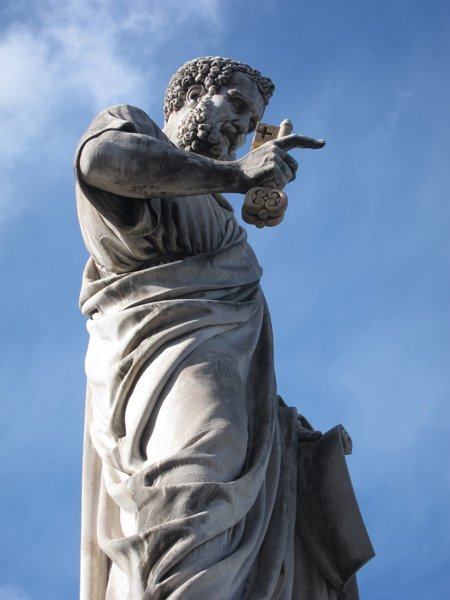 A statue of St. Peter in St. Peter's Square at the Vatican. The conclave to pick a new pope will begin on Tuesday (March 12) the Vatican said Friday, resolving an open question that had dogged the cardinals meeting here over the past week. RNS photo by David Gibson