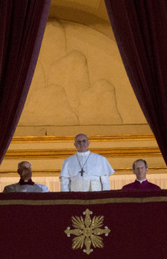 Newly elected Pope Francis appears on the central balcony of St. Peter's Basilica on Wednesday (March 13) in Vatican City. Now, he faces first-year scrutiny. RNS photo by Andrea Sabbadini