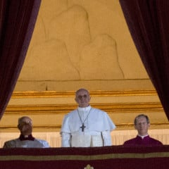 Newly elected Pope Francis appears on the central balcony of St. Peter's Basilica on Wednesday (March 13) in Vatican City. Argentinian Cardinal Jorge Mario Bergoglio was elected as the 266th Pontiff and will lead the world's 1.2 billion Catholics. RNS photo by Andrea Sabbadini