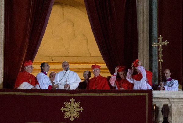Newly elected Pope Francis appears on the central balcony of St. Peter's Basilica on Wednesday (March 13) in Vatican City. RNS photo by Andrea Sabbadini