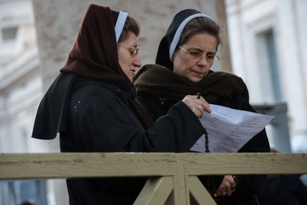 Nuns in St Peter's Square wait to find out whether the College of Cardinals have elected a new Pope on March 12, 2013 in Vatican City, Vatican. RNS photo by Andrea Sabbadini