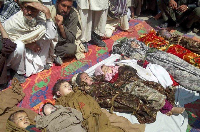 Afghan families gathered around bodies of children killed in US bombing