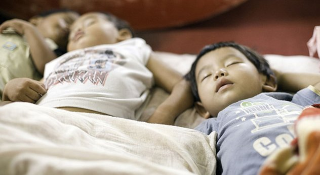 Children sleep in an orphanage in Nepal. Courtesy of Flickr Creative Commons (bit.ly/102eiwp)